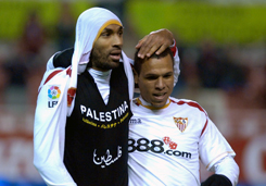 Sevilla's Frederic Kanoute celebrates scoring a goal by unveiling a t-shirt displaying his support for Palastine