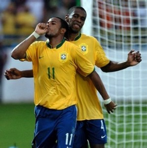 Brazil's footballer Robihno (L) celebrates his second goal against Chile with teammate Juan during their Copa America 2007 first round match 01 July 2007 in Maturin, Venezuela. AFP PHOTO/GERARDO MORA (Photo credit should read GERARDO MORA/AFP/Getty Images)