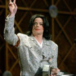 Michael Jackson accepts his award as artist of the century at the 29th American Music Awards in Los Angeles, Wednesday, Jan. 9, 2002. (AP Photo/Kevork Djansezian)